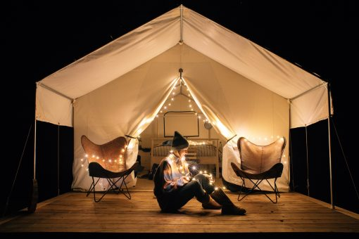 Girl on Deck of Glamping tent